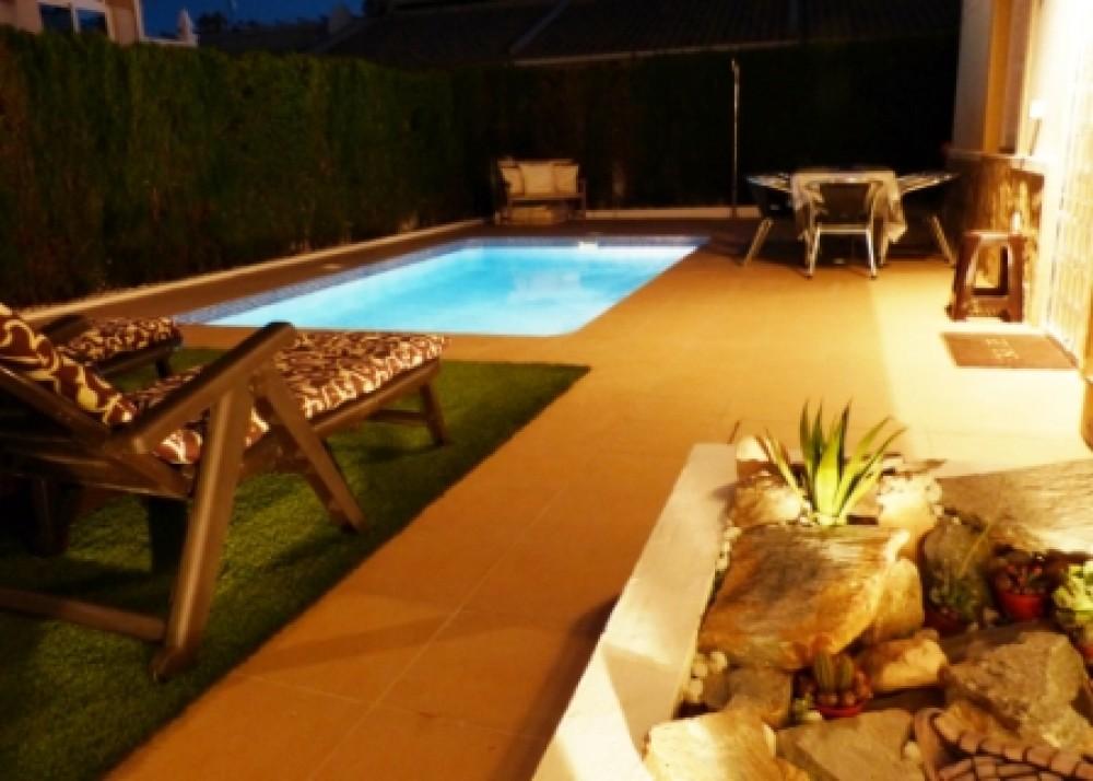 Villamartin vacation rental with Pool Area at Night