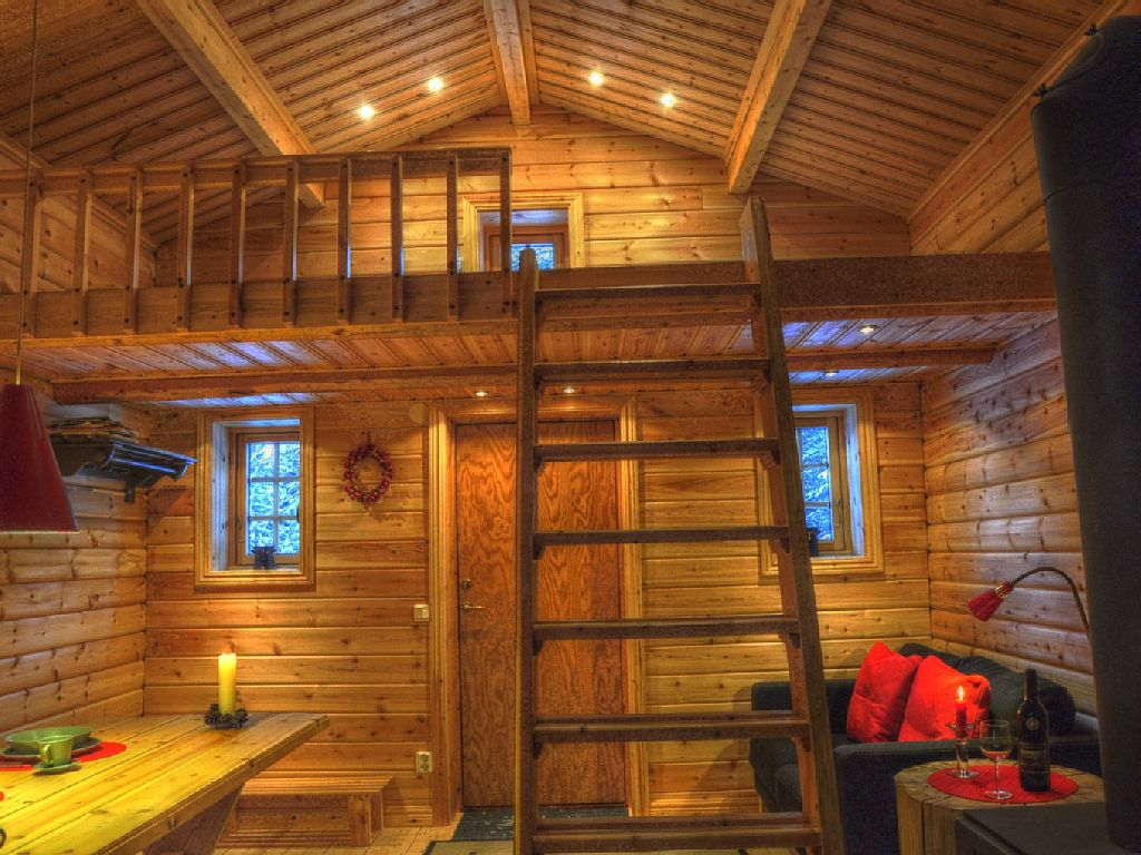 RUSTIC COTTAGE IN THE WOODS OF LAPLAND ON THE RIVER