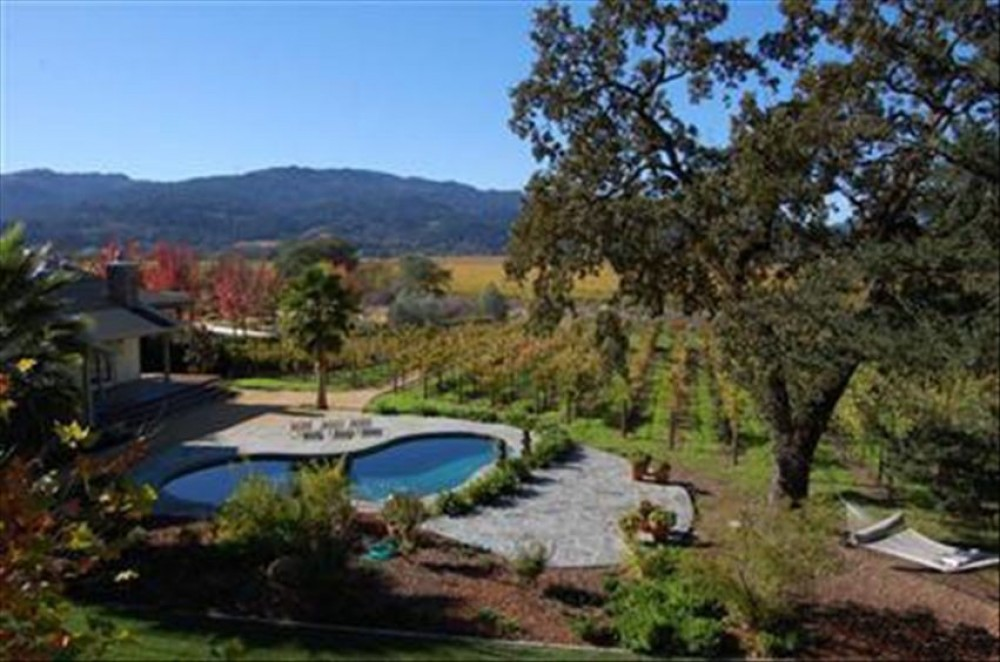 napa vacation rental with view from Master Bedroom - pool and vineyard