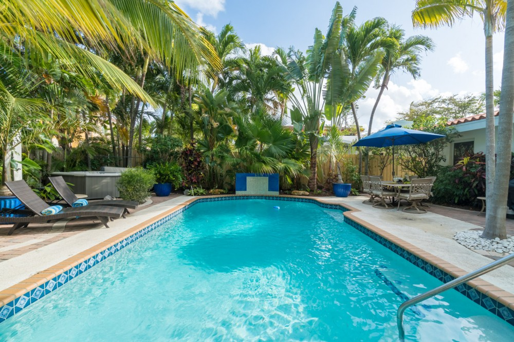 Fort Lauderdale vacation rental with Large heated pool with custom sheer waterfall.