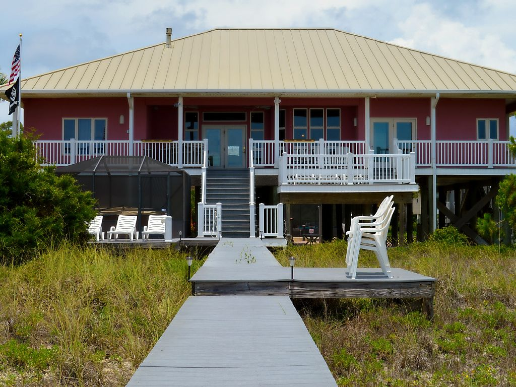 Five Bedroom Beach House with an enclosed pool and an enclosed hot tub