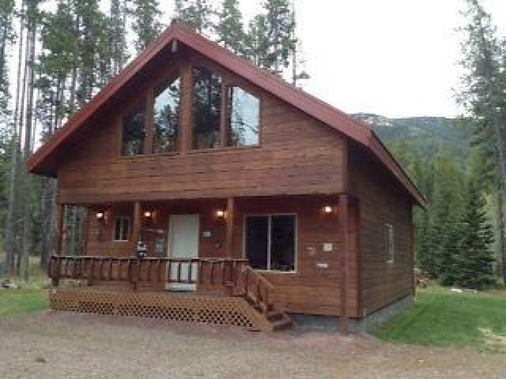 glacier national park vacation rental with FRONT OF CABIN IN SUMMER