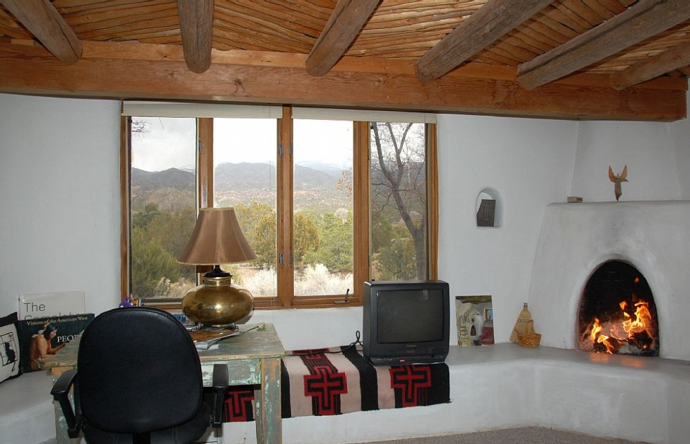 Master Bedroom with Fireplace and Views Airbnb Alternative santa fe New Mexico Rentals