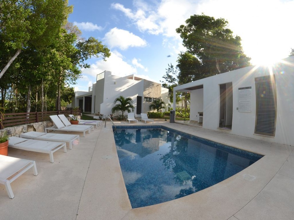 Akumal vacation rental with swimming pool just behind the condo