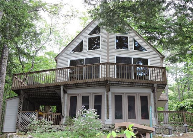 Winnipesaukee-Lovely home w/lots of glass facing the water in peaceful Cove.