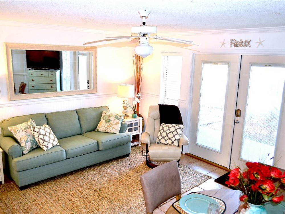perdido key vacation rental with Living room with exterior door to patio/pool