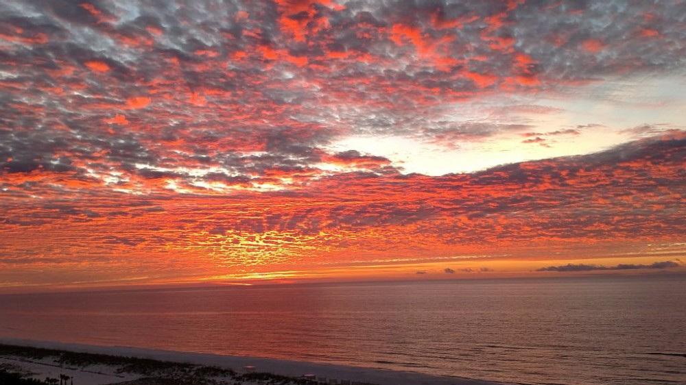 Pensacola Beach vacation rental with Stunning sunsets abound from the balcony