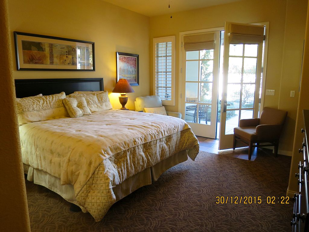 King Sized Bed, Private Patio, Fronting on Sparkling Pool and Hot Tub