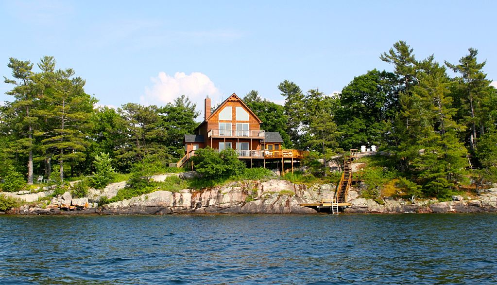 Ti Swiss Miss, Channel Side Home with Protected Dock in Bay Behind House!