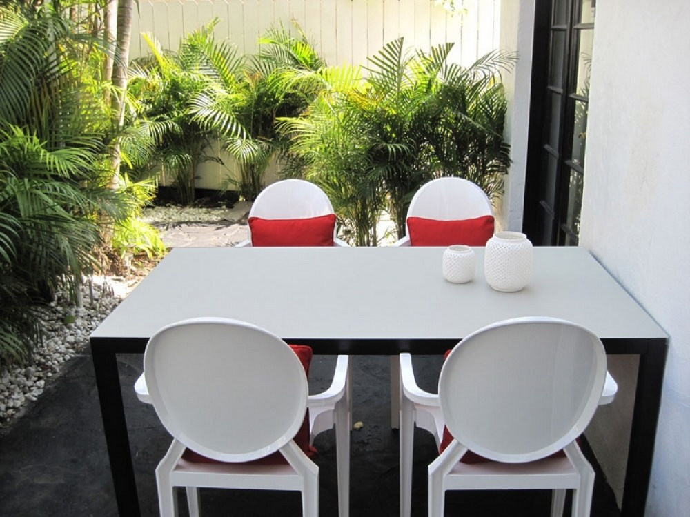 Miami Beach vacation rental with Patio by Pool Area with seating & BBQ Grill