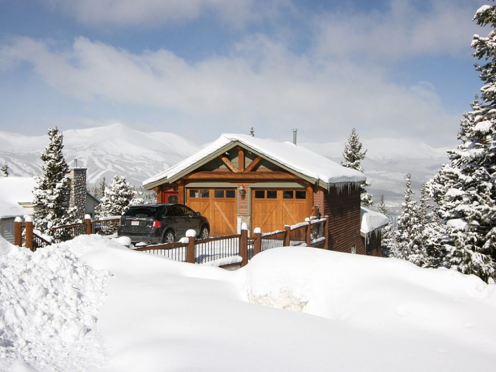 Breckenridge vacation rental with Front of house with ski runs in background