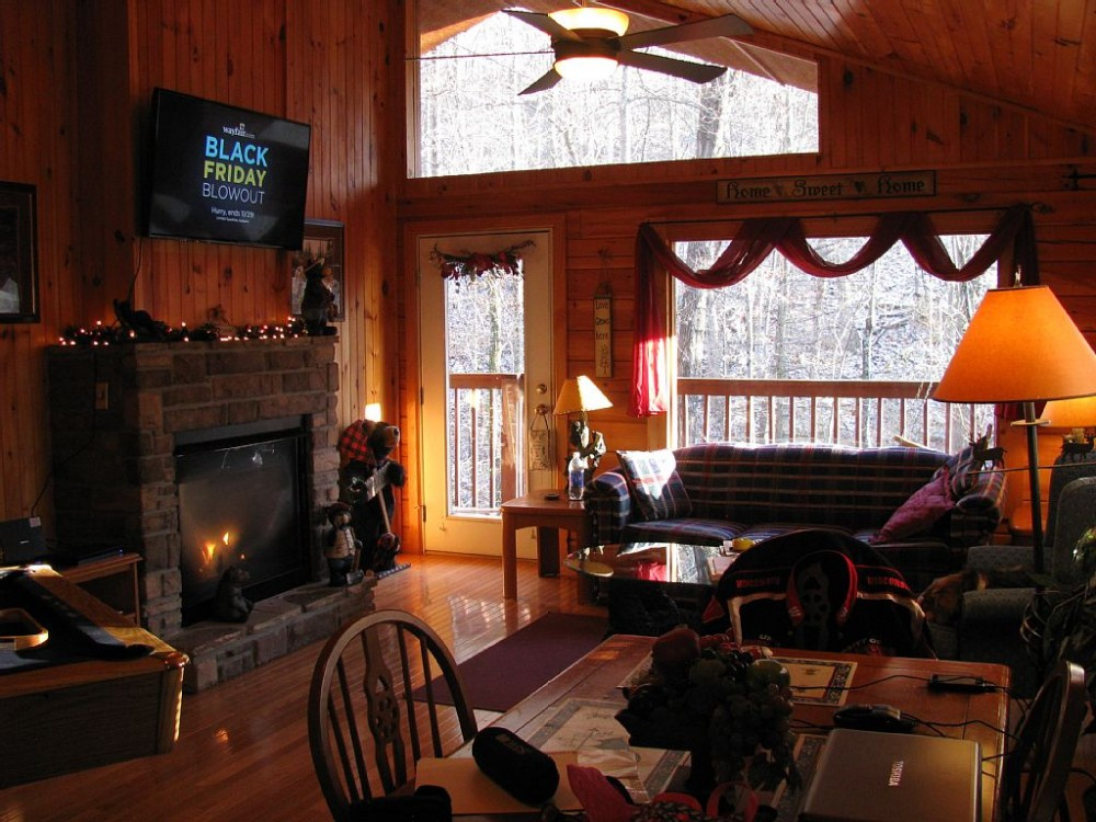 Pigeon Forge vacation rental with 2 sided fire place visible from great room ..