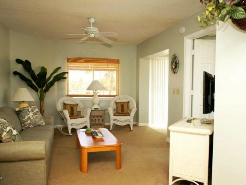 Cape Canaveral vacation rental with Living room w/ pull out sofa & flat screen TV