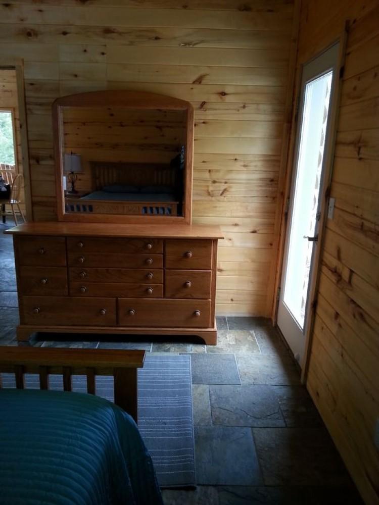 Bedroom door to side of cabin Woodland Park vacation home
