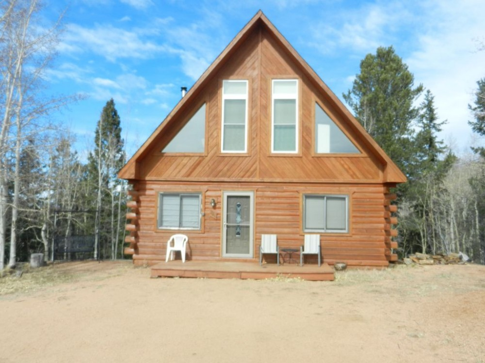 Cripple Creek vacation rental with Log Cabin Getaway .  Front of cabin