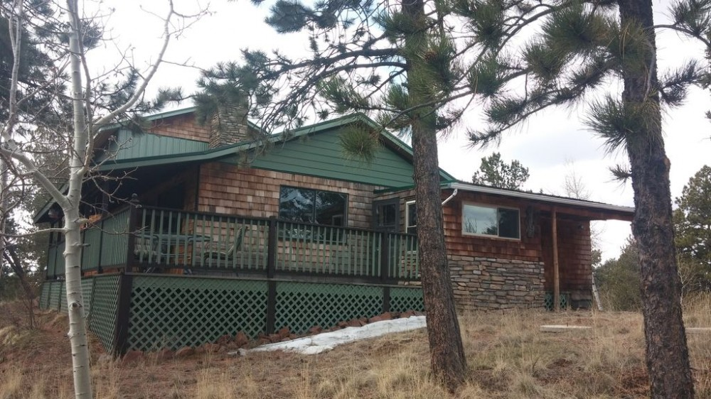 Cripple Creek vacation rental with The side entrance of the cabin brings you into the kitchen.