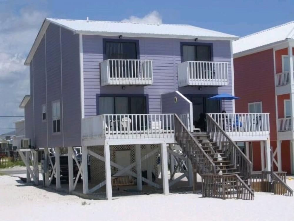 Gulf Shores vacation rental with Toto viewed from the sandy beachfront!