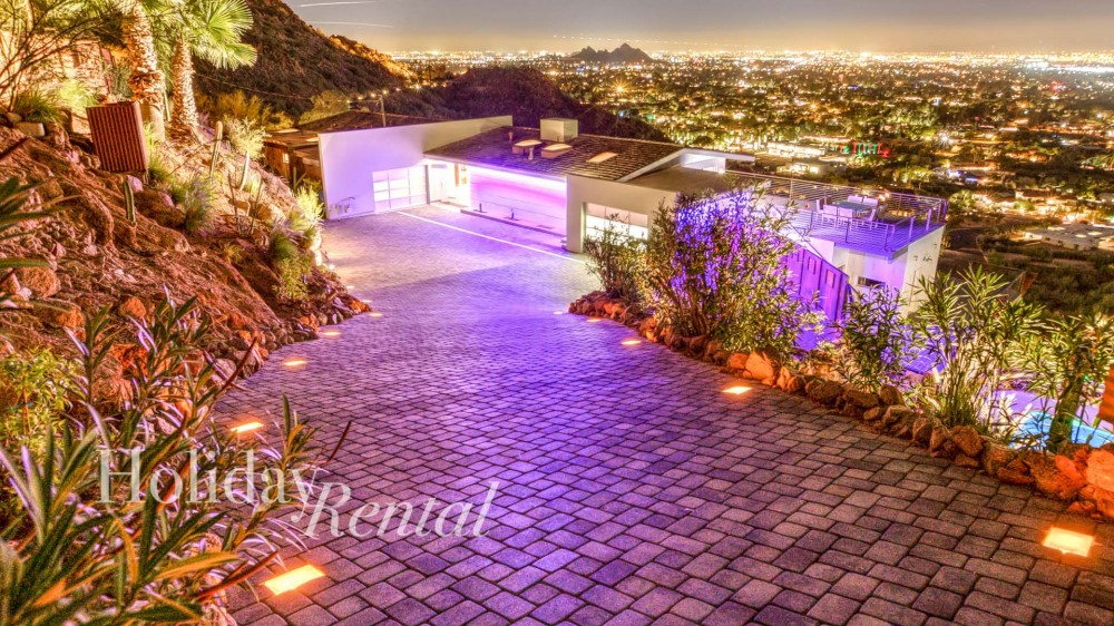 Phoenix vacation rental with Driveway view down to the house  with city lights views