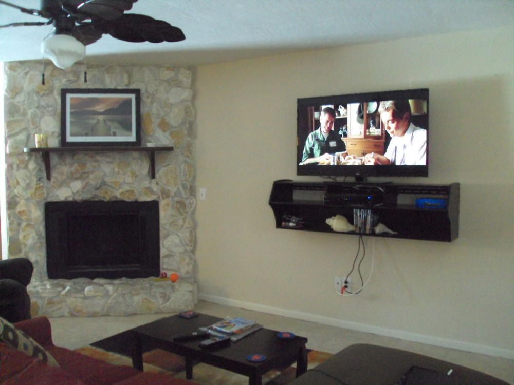 Port St. Lucie vacation rental with Beautiful stone fireplace in living Room with open floor plan