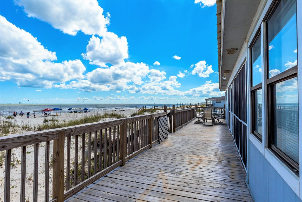 Gulf Shores vacation rental with Back patio with seating for fun and sun