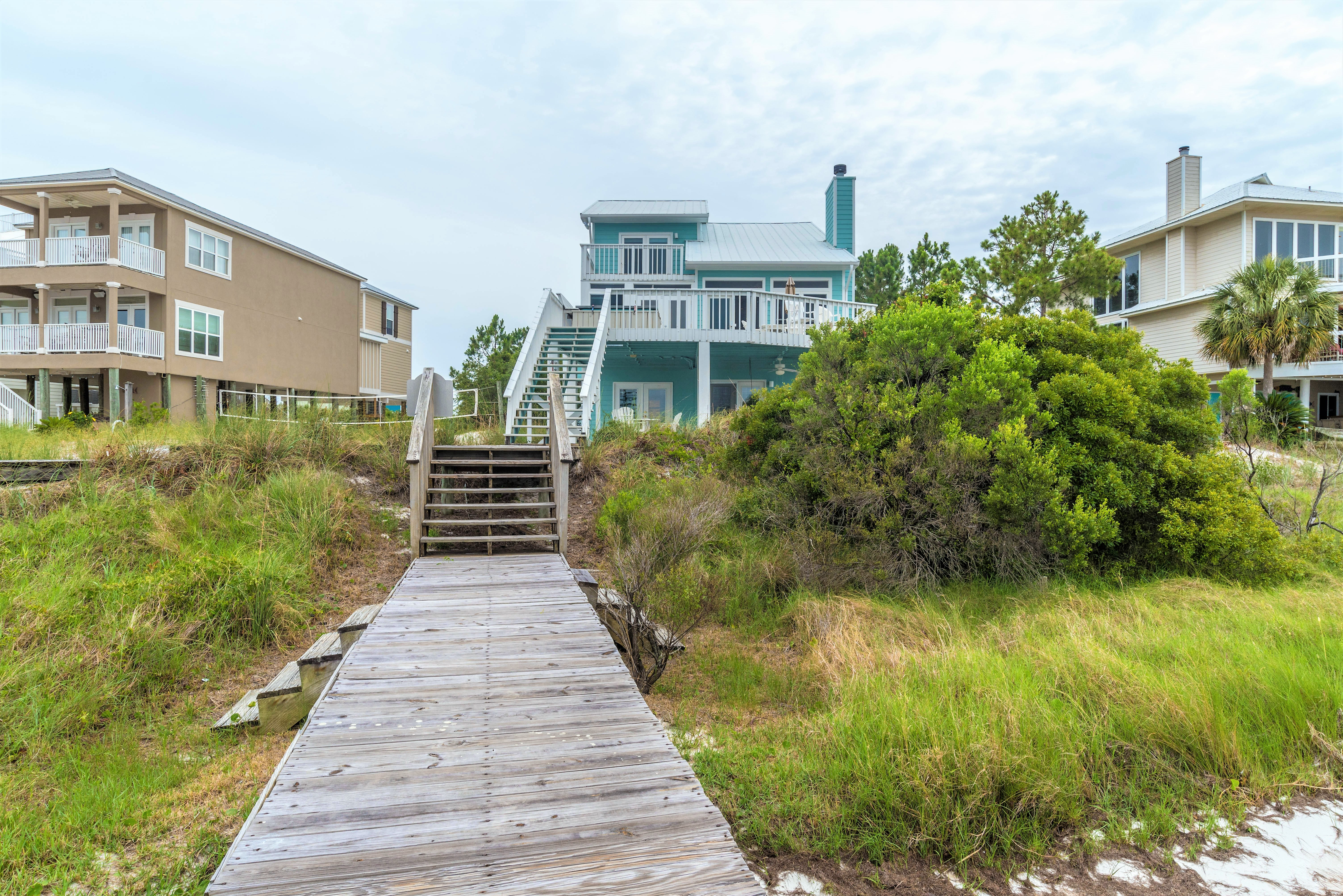 Waterfront home with FISHING PIER, BOAT LIFT, AND SAND VOLLEYBALL COURT!!