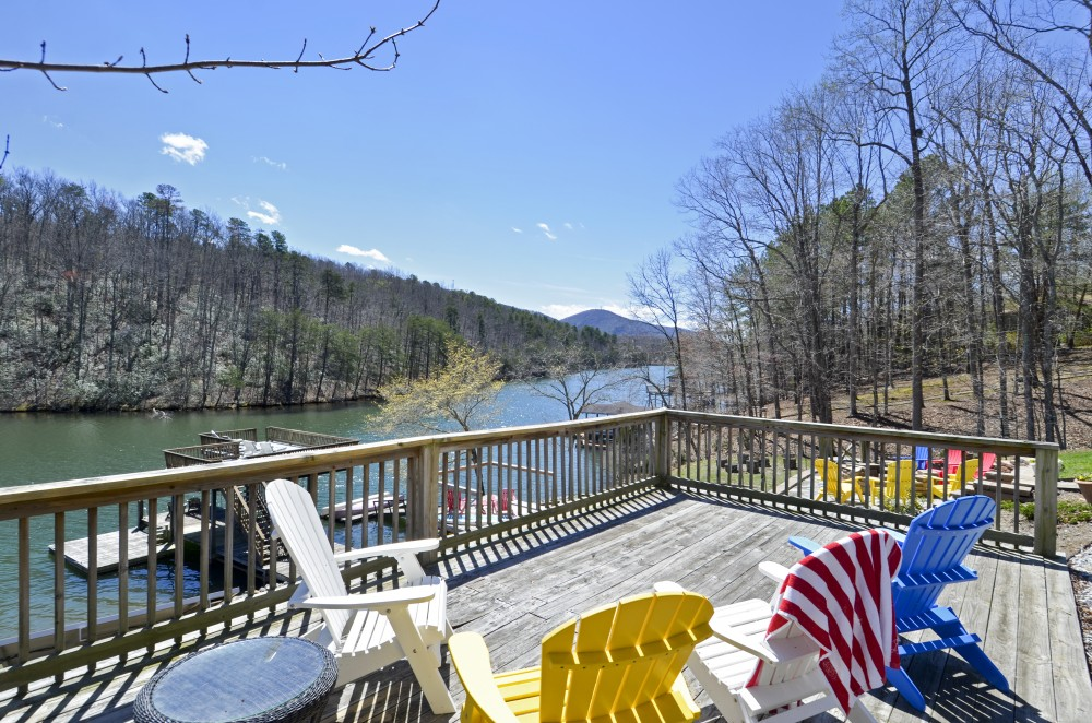 Huddleston vacation rental with Deck with Chairs near Fire pit and water  surrounded by Privacy