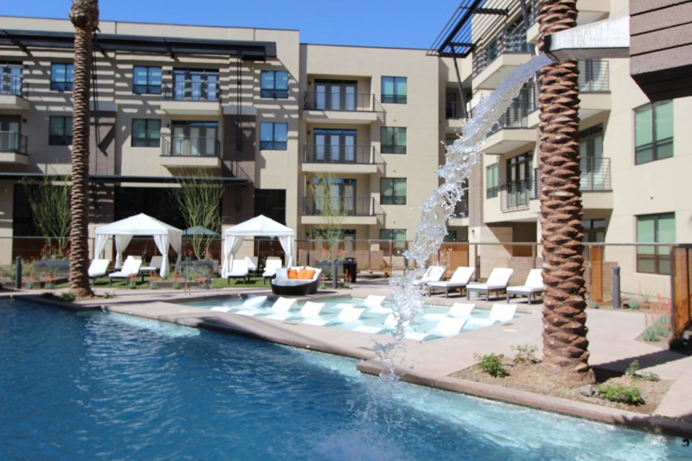 Scottsdale vacation rental with Resort  like pool, cabanas, lounge chairs.