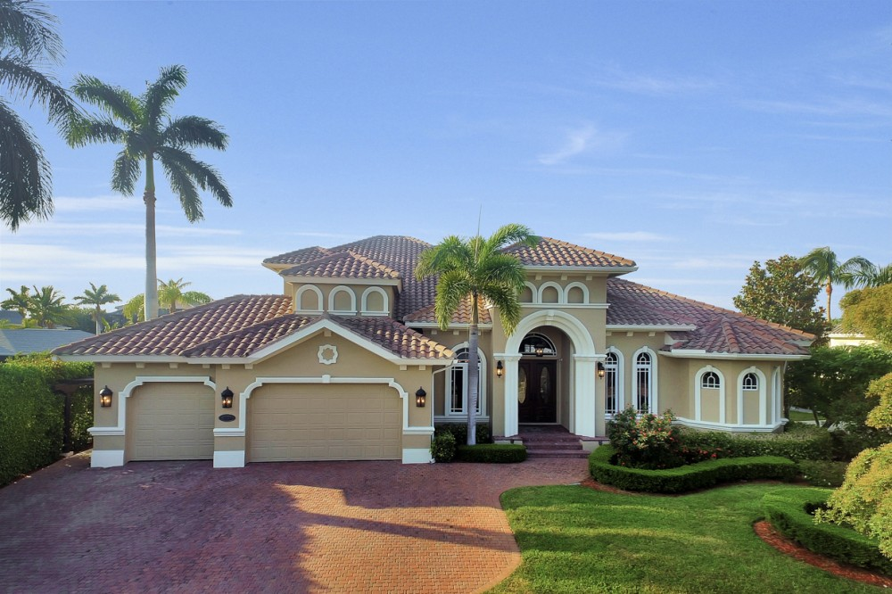 Marco Island vacation rental with Street view of this gorgeous 2 story home on Winterberry Drive