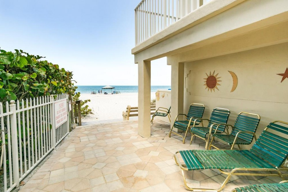 Indian Shores vacation rental with South side deck area leading to beach