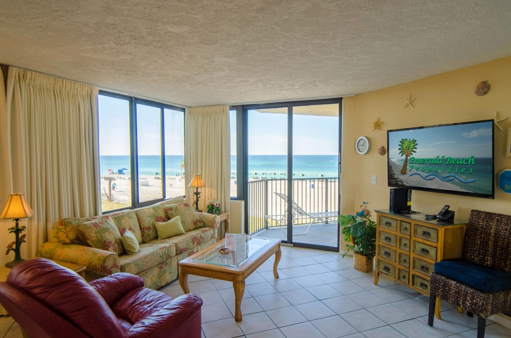 Panama City Beach vacation rental with Surfside Sandcastle  Sunbird 208W Panama City Beach  FL   Make this your Perfect Place in Paradise   The great room has a man-sized flat-screen TV  a luxurious queen-sized sleeper sofa and a comfy leather swivel rocker recliner