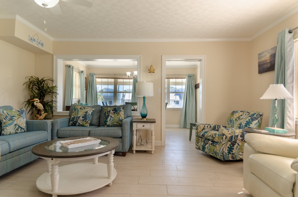 Panama City Beach vacation rental with You ll love the spacious open floor plan in the great room   Plenty of seating for everyone with a sleeper sofa and love seat set and matching swivel rocker chair AND a mansized leather recliner  too
