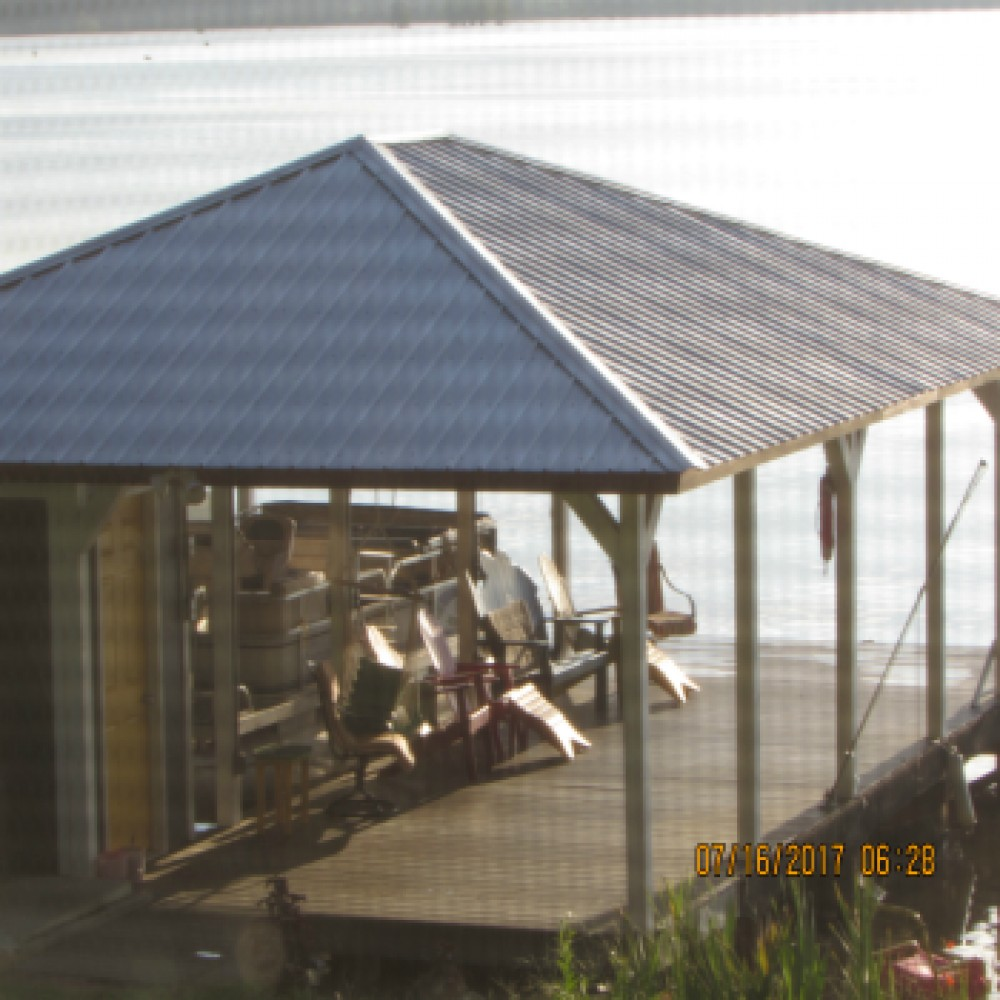 Cobb vacation rental with Covered dock located on the channel