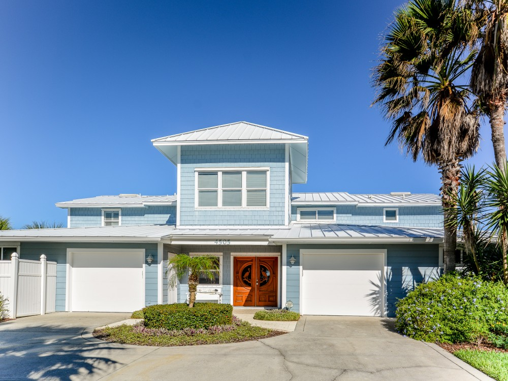 New Smyrna Beach vacation rental with Located on a quiet beach-side street  enjoy 8 bedrooms and 7 full bathrooms