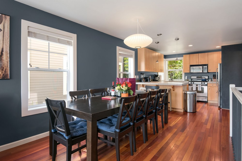 Seattle vacation rental with The open concept entertaining area flows from living room to dining area to kitchen