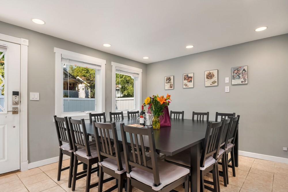 Seattle vacation rental with The dining table is the centerpiece of this home  with a table set for 14 and additional folding chairs available