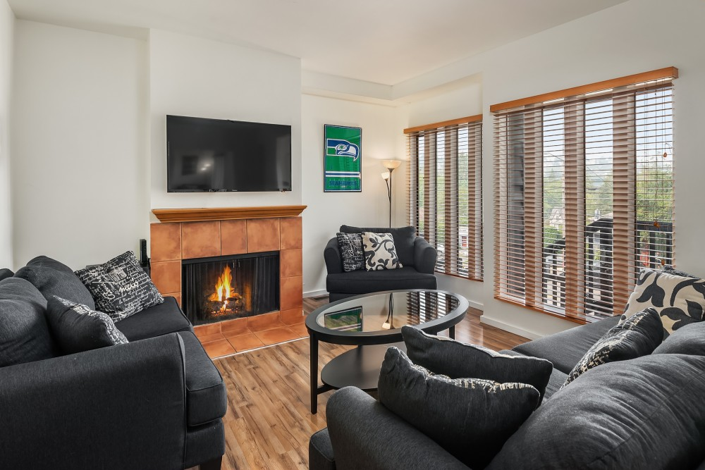 Seattle vacation rental with The cozy  light-filled living room has plenty of room and overlooks Madison Street