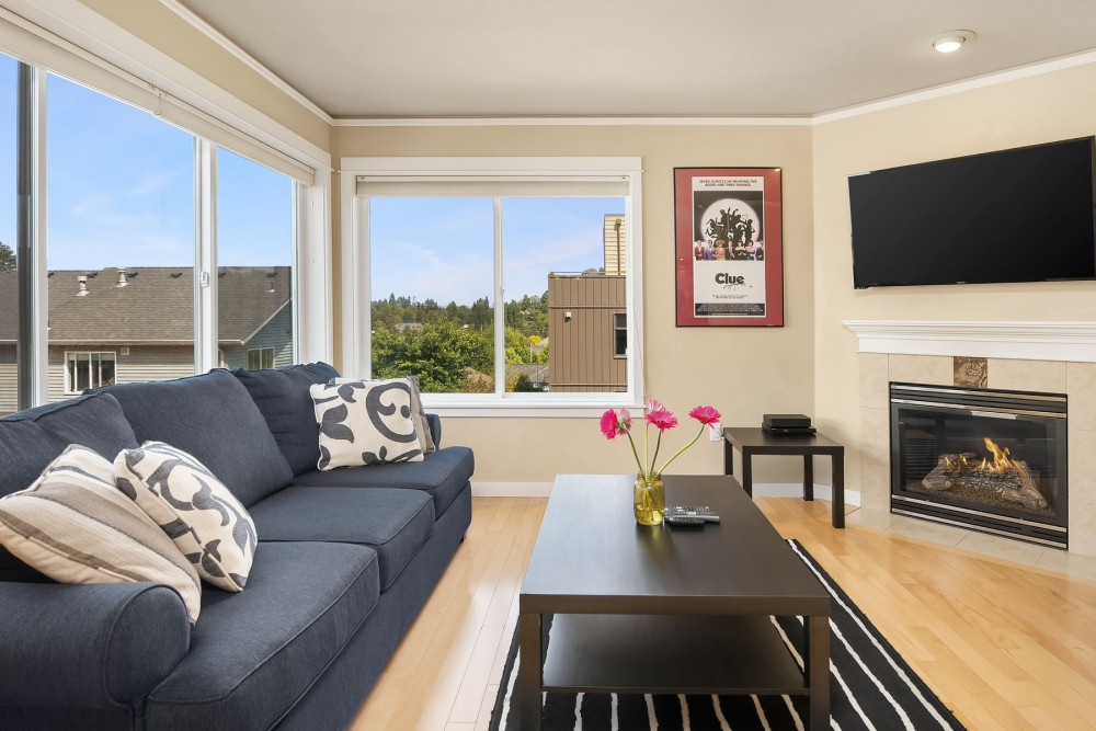 Seattle vacation rental with The living room includes a queen size sleeper sofa with super comfortable mattress