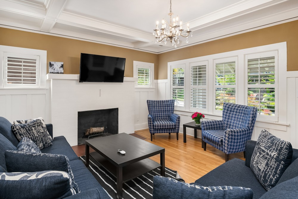 Seattle vacation rental with The bright  spacious living area features a comfortable queen size sleeper sofa  love seat  50  tv  DVD  and a decorative fireplace