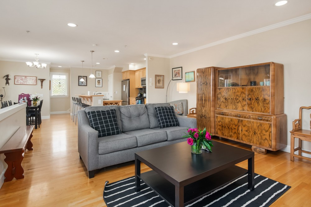 Seattle vacation rental with The warm living room features a large TV with DirecTV and lots of comfy places to curl up with a  good book or to enjoy the art