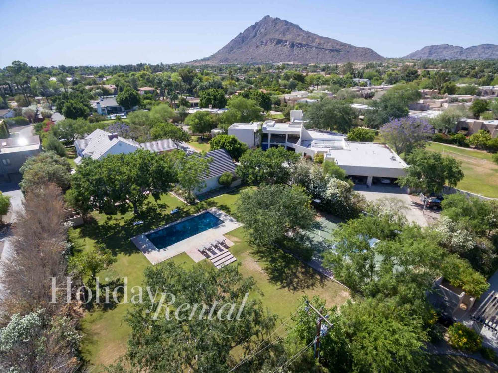 Scottsdale vacation rental with Arial Shot of Chateau to the left  and our other 8 bedroom home called Scottsdale Adobe Grande to the right