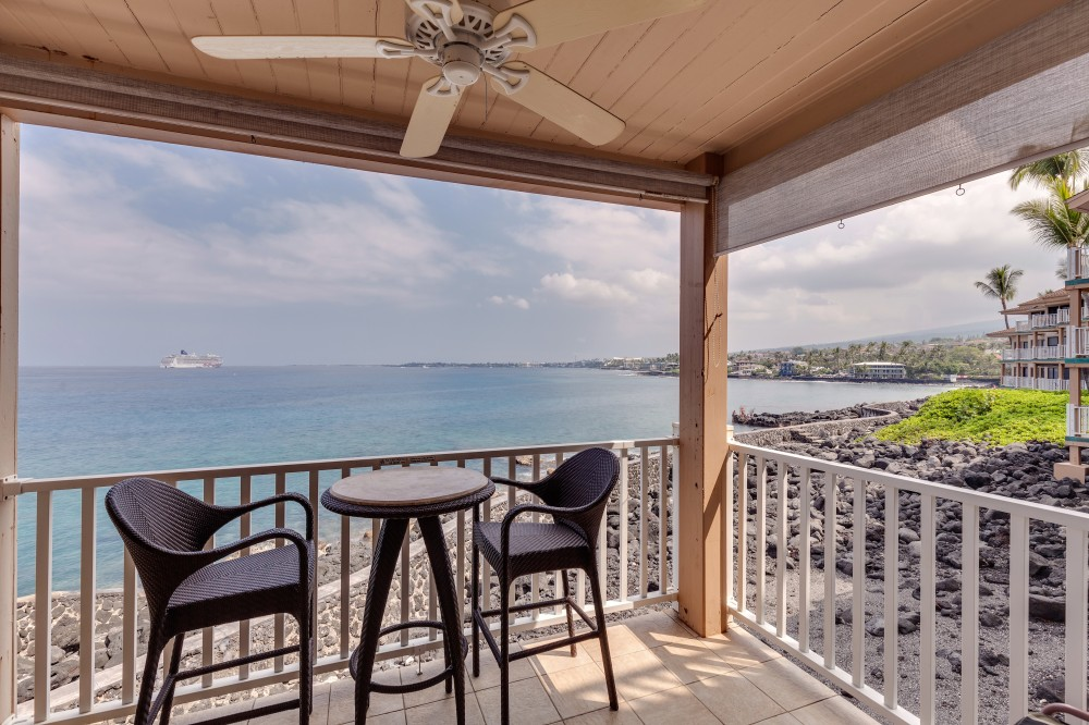 Kailua-Kona vacation rental with Sit and relax at the oceans edge.  Enjoy panoramic ocean views and amazing sunsets.