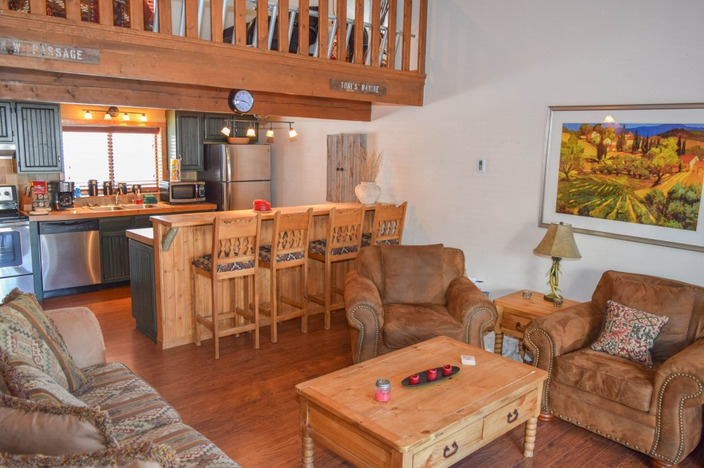 Red River vacation rental with view from living room to kitchen with bar