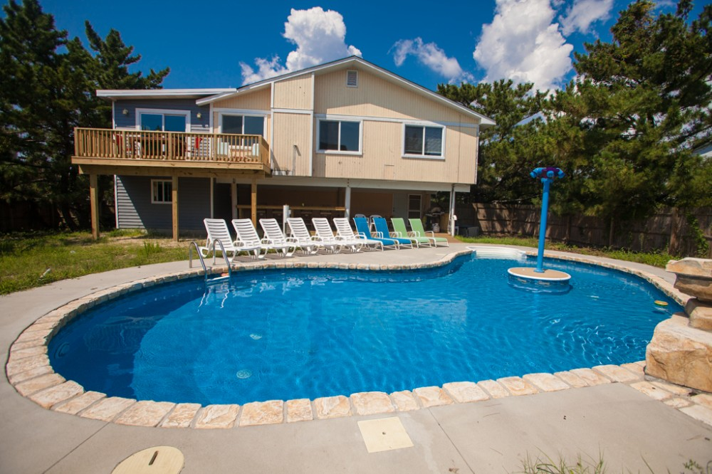 Virginia Beach vacation rental with OCEAN ROSE- Fun   unique dog-friendly home w  6 themed bedrooms   private pool  short walk to the beach