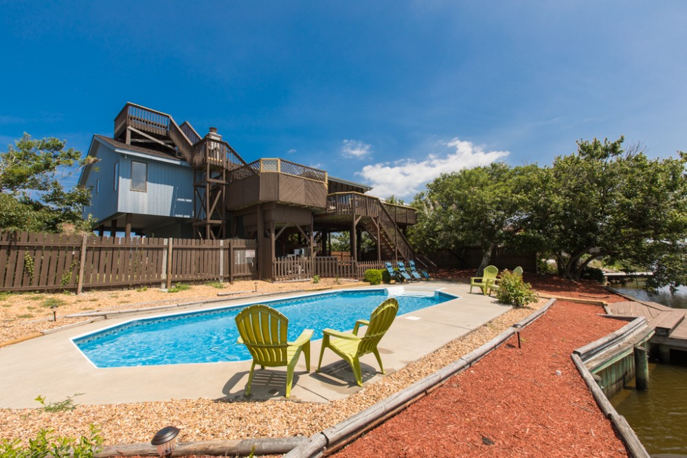 Virginia Beach vacation rental with SOLAR PLEASURE- Classic dog friendly beach cottage on the canal with private pool  hot tub    dock