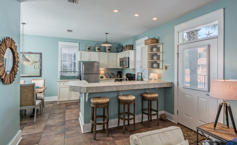 Santa Rosa Beach vacation rental with Front door to right with Breakfast Bar  Kitchen and Dining Room Area left pictured