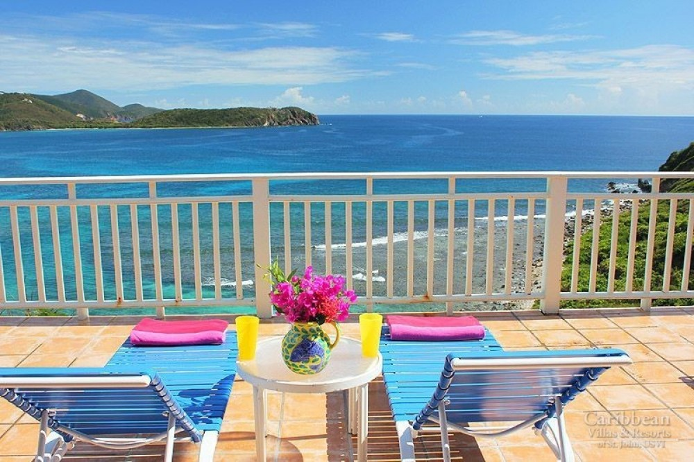 Cruz Bay vacation rental with Rara Avis – Come relax in your lounge chairs and listen to the surf of Hart Bay!