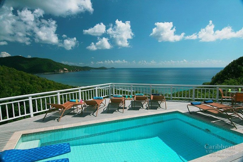 Reef Bay vacation rental with It's time to relax in the lounge chairs by  the pool and enjoy the easterly view!