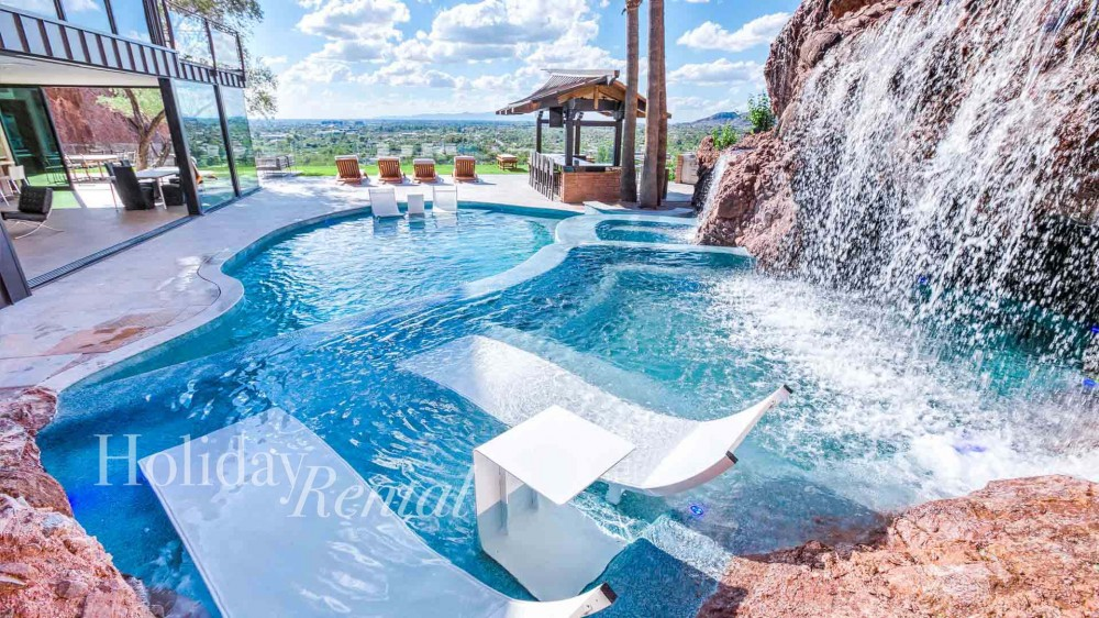 Phoenix vacation rental with Amazing city views from the luxurious pool  Swim up grotto to the right  hot tub is next to the grotto
