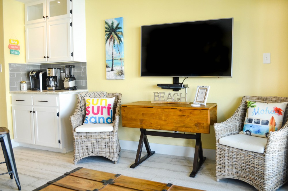 Galveston vacation rental with 55  UltraHD 4k TV with FREE Netflix and Smart Blu-Ray player  Dining table  too  Oceanview just to the right through the sliding glass doors