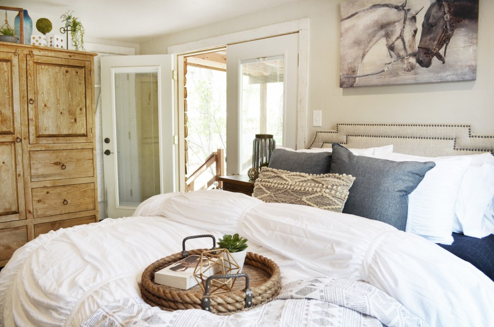 Ruidoso vacation rental with Beautiful bedroom with armoire for extra storage and french doors leading out to the back deck  Smart locks on both the front and back  so no worries about keys- you get your own code for your stay